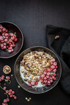 Granola with soy milk and redcurrants