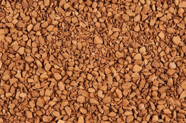 インスタントコーヒーの背景の顆粒
