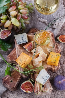 Grape, cheese, figs and honey .cheese board.