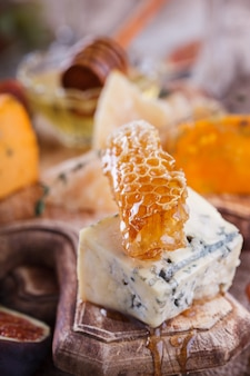 Grape, cheese, figs and honey .cheese board