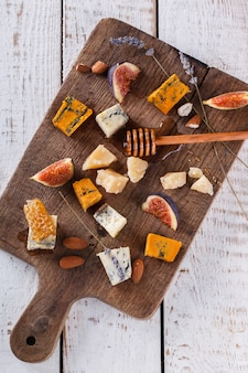 Grape, cheese, figs and honey. cheese board.