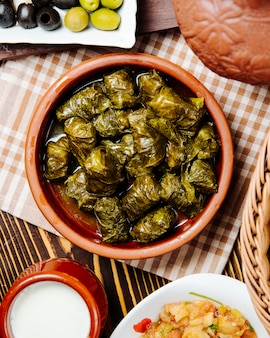 Grape leaves dolma minced meat grape leaves plain youghurt spices top view