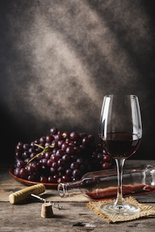 Grape wine on wooden table
