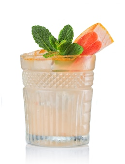 Grapefruit alcohol cocktail with gin isolated on white