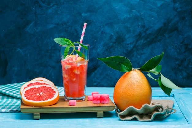 Grapefruit and drink with picnic cloth