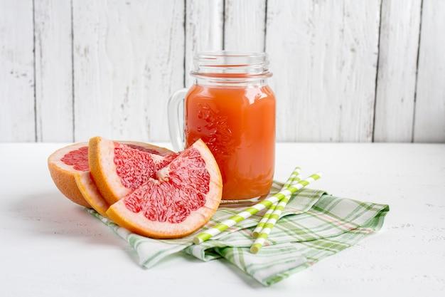 Grapefruit juice in a jar