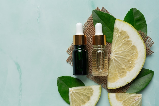 Grapefruit oil serum bottle put on green light background