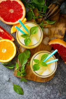 Grapefruit and orange gin cocktail or margarita refreshing drink with ice top view flat lay