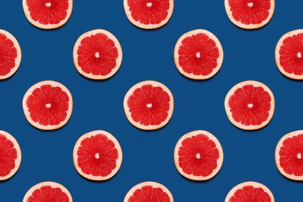 Grapefruit slices seamless pattern