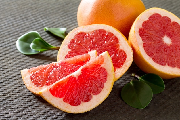 Grapefruit sweetie on a concrete gray table