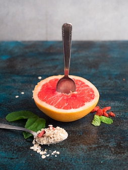 Grapefruit with oatmeal on blue table
