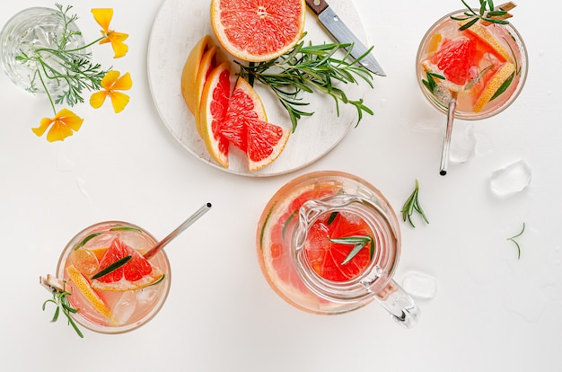Grapefruits iced drink with rosemary. top view