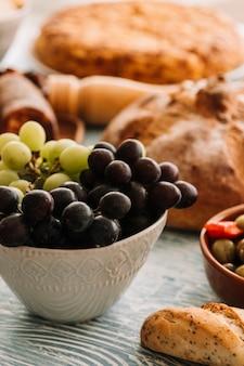 Grapes near fresh bread