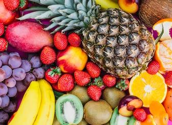 Grapes; strawberries; pineapple; kiwi; apricot; banana and whole pineapple