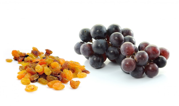 Grapes with raisins isolated on white