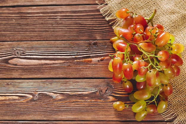 Grapes on a wooden table copsyspace