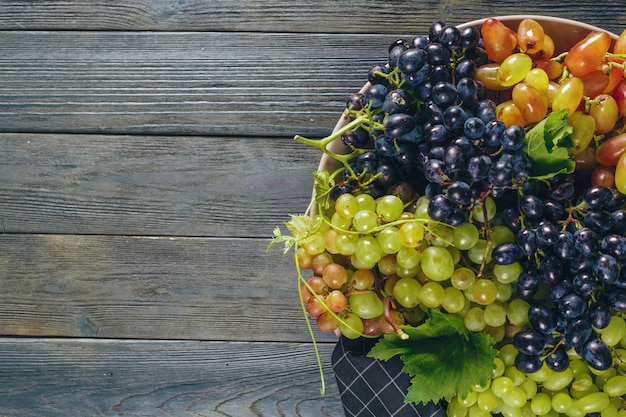 Grapes on a wooden table, copyspace
