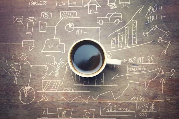 그래프와 나무 테이블에 커피 한잔