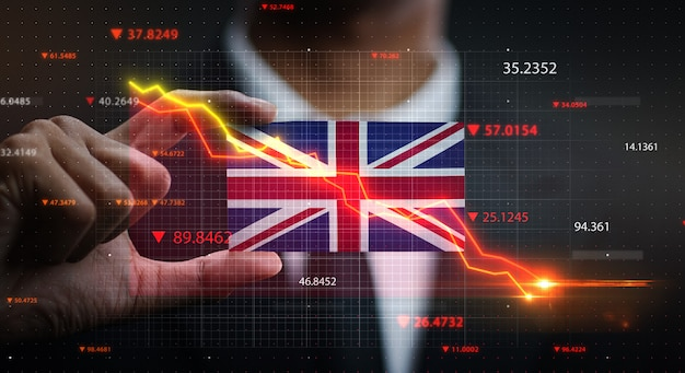 Graph falling down in front of united kingdom flag. crisis concept