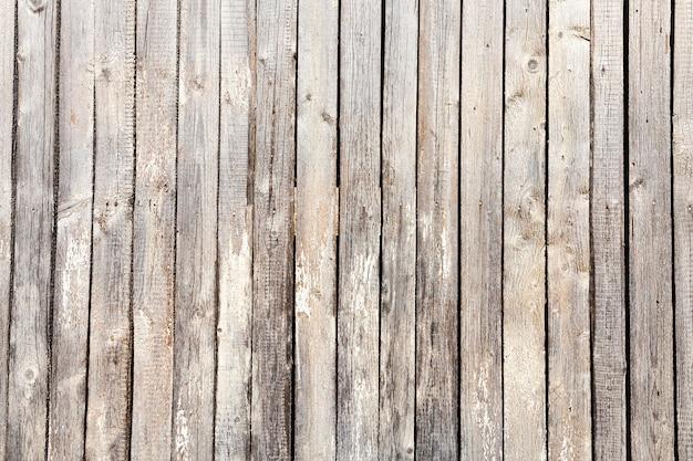 板で作られたグラフ化された木製の表面。古い建物の一部
