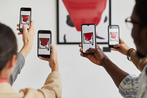 Graphic background of multiple people taking smartphone photos of painting at modern art gallery exhibition,