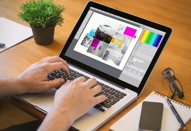 グラフィックデザインのコンセプト。画面上のグラフィックデザインソフトウェアでラップトップに取り組んでいるデザイナー。