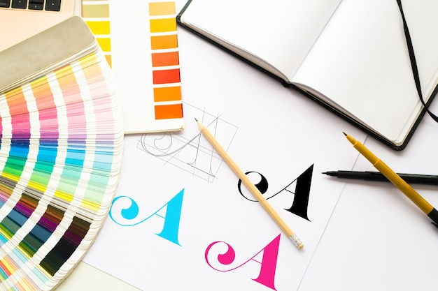 Graphic design logo composition with tools and color schemes