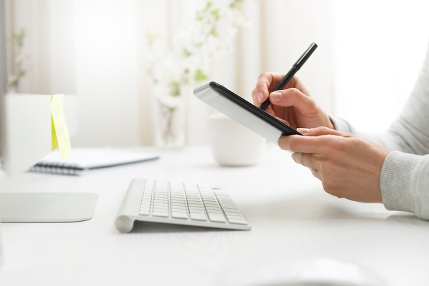 A graphic designer draws on a tablet.