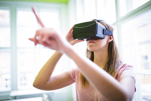 Graphic designer gesturing while using virtual reality headset