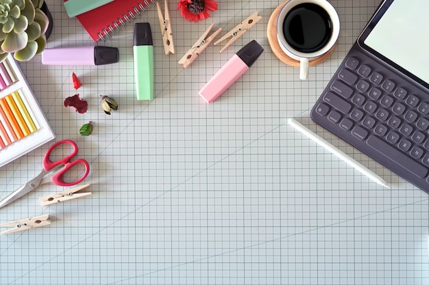 Graphic designer's workspace with a pencil tablet,  computer, color swatches and copy space