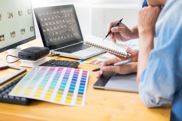 Graphic designer team working on web design.