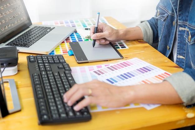Graphic designer team working on web design