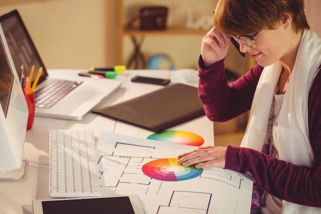 Graphic designer working at desk