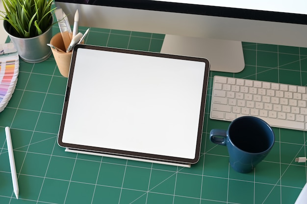 Graphic designer workplace tablet and desktop computer blank screen