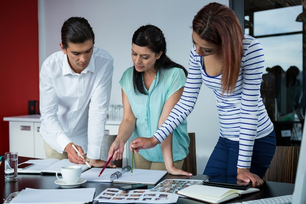 Graphic designers  discussing over photographs