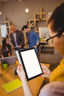 Graphic designers using digital tablet