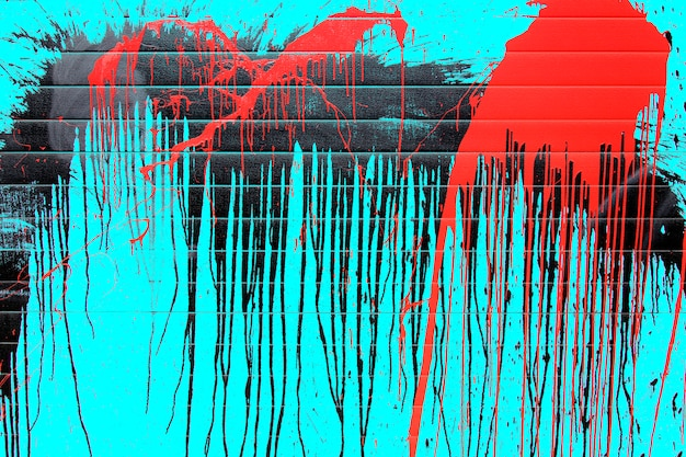 Graphic drips of red and black paint on a blue background.