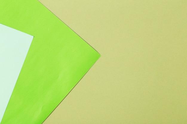 Graphic multicolored green cardboard background