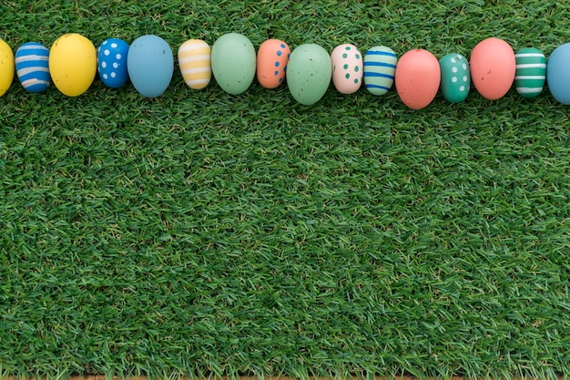 Grass background with row of easter eggs