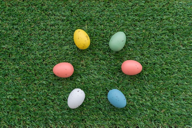Grass surface with six colored eggs for easter day