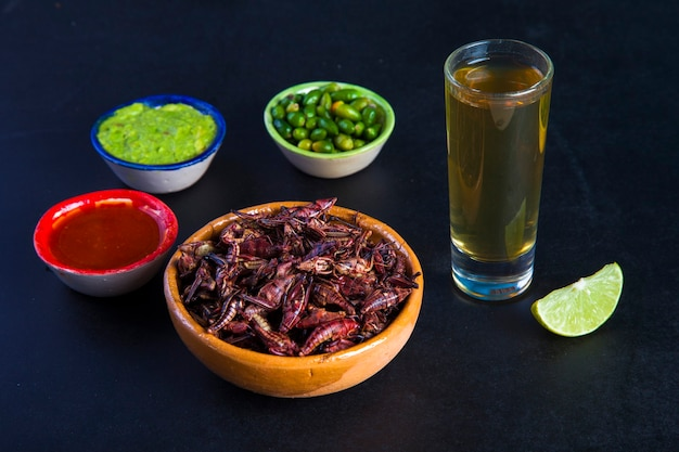Grasshoppers chapulines and tequila. traditional mexican food