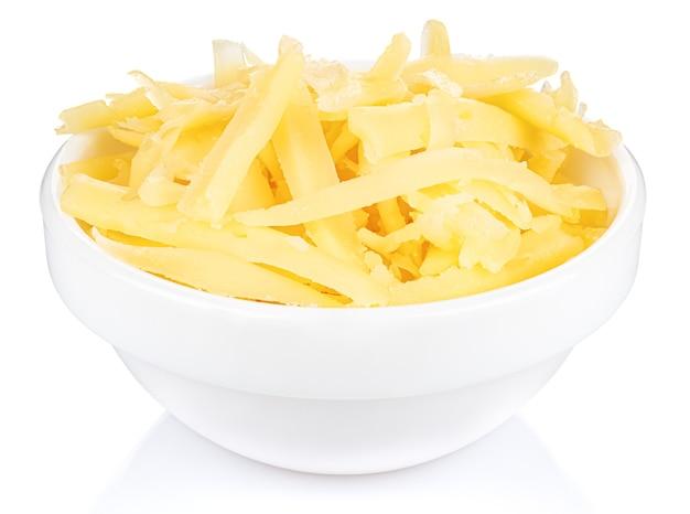 흰색 절연 작은 흰색 세라믹 둥근 그릇에 강판 된 치즈
