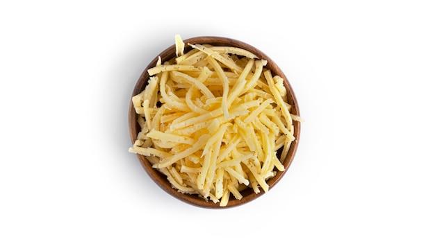 절연 나무 그릇에 강판 된 치즈입니다.