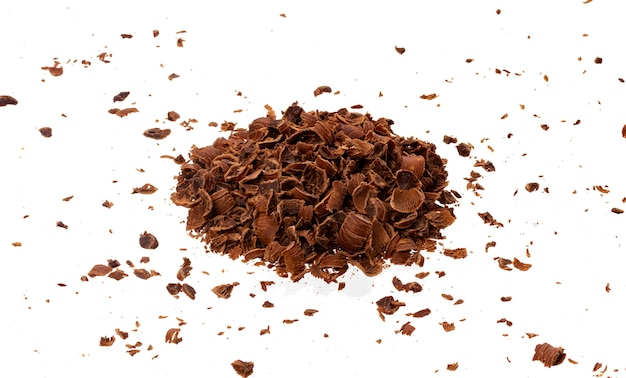 Grated chocolate. pile of ground chocolate isolated, closeup