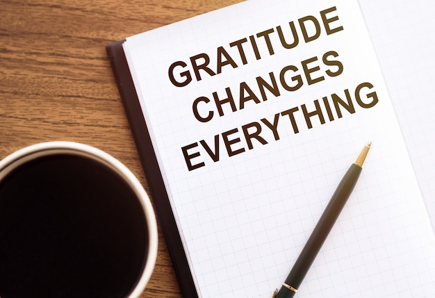 Gratitude changes everything - motivation writing on a notebook on table