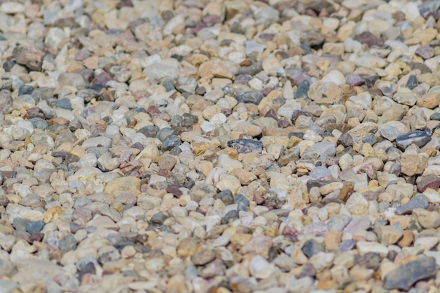 Gravel background texture. close up of little stones on the ground. selective focus.