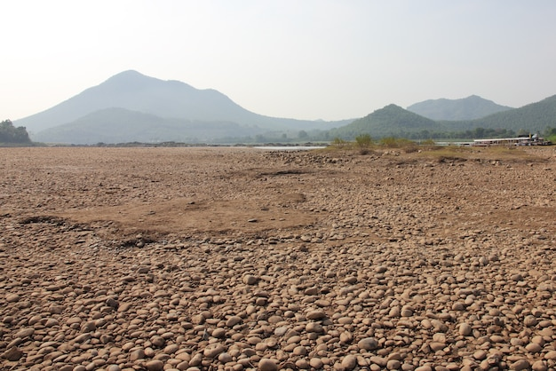 Gravel bed of the river bed with mountain
