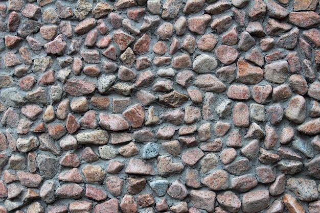 Гравий каменная стена фон и текстура