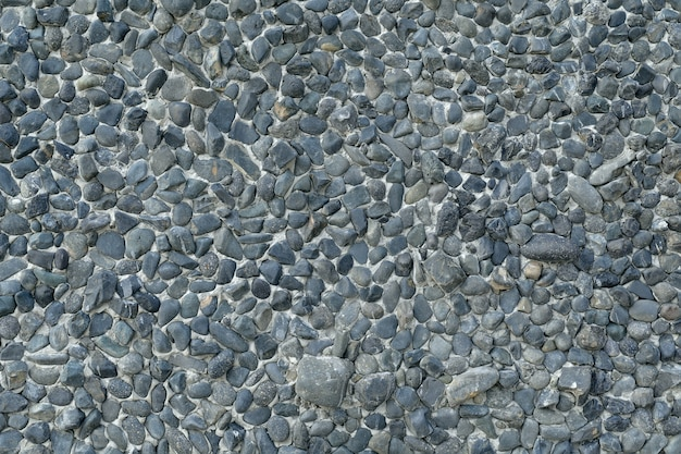 Gravel stone wall texture background small stones that have been eroded by water are used to decorate the wall.