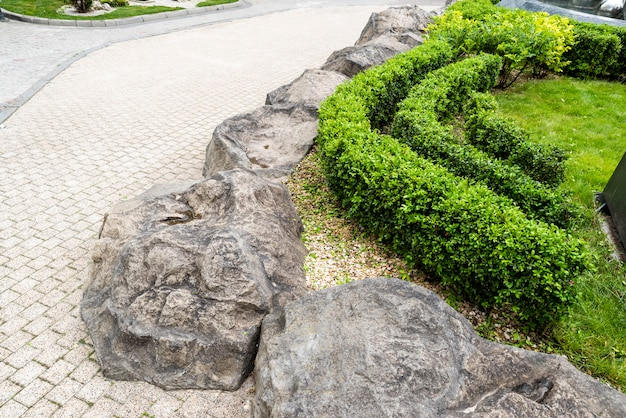 Gravel and stones in the decoration of flower beds in landscape design